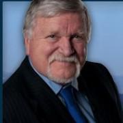 Tom Hughes wins close race for Metro president