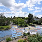On NE Holman, an intersection transformed by paint and neighbors