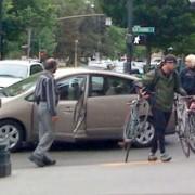 Woman riding a bicycle rear-ends Mayor Adams in his Prius