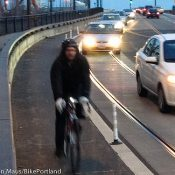 PBOT installs bollards to protect Lovejoy ramp bike lane – Updated