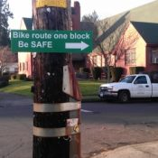 """Unofficial sign says """"Be Safe,"""" don't ride on NE Ainsworth"""