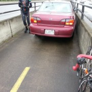 Riders discover woman driving car on I-205 Bridge bike path