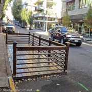 Fearing parking loss, downtown business group stops 'Street Seats' program