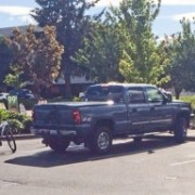 Truck driver does 'rolling coal' on riders, and one of them is a bike cop