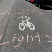 Grafitti in northwest Portland rages against blinking bike lights