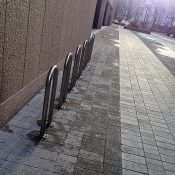 Poorly installed bike racks in renovated Bancorp Tower plaza