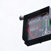 "Right-hook risk drops with flashing ""Yield to Bikes"" sign on NE Couch"