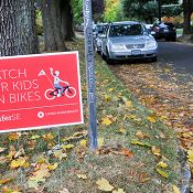 Real estate firm's free signs encourage residents to 'Watch for kids on bikes'