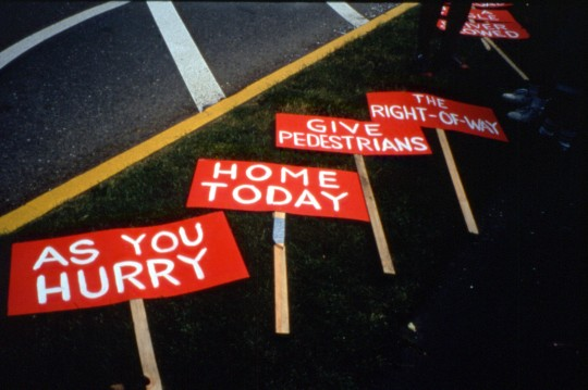 """Burma Shave"" signs by Doug Klotz on the ground before the 5/14/02 Grant Park pedestrian action."