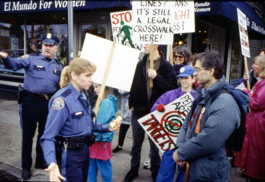 Earth Day, April 20, 1996 Officers stop to tell WPC to be careful crossing the street.