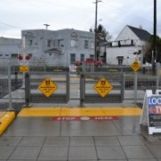 Despite objections, TriMet installs swing-gates at 11th Avenue rail crossing
