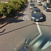 City uses paint and plastic to enhance bike lane on SW 13th at Clay