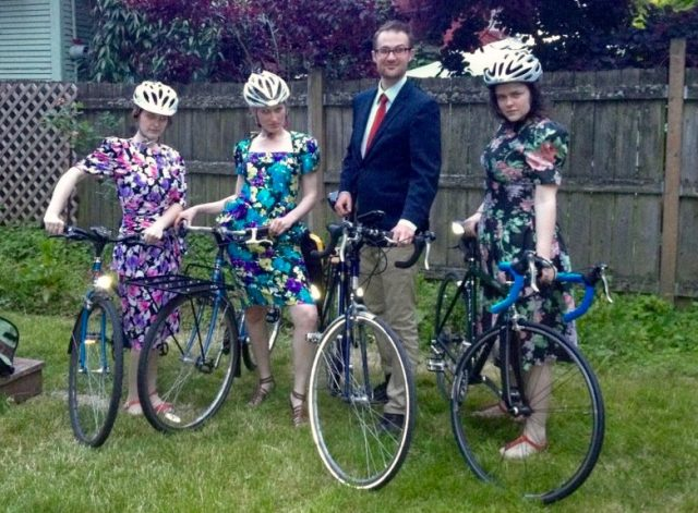 Three 80's prom dress beauties and one handsome beast.