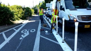 City crews installed a new plastic curb at SW 13th and Clay today.(Photos: City of Portland)