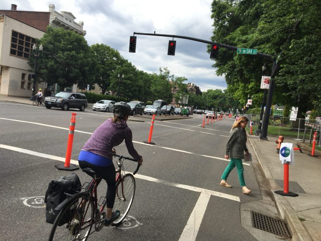 The cones and wide bike lane are temporary, the legal requirement to stop at lights is not.(Photo: J. Maus/BikePortland)