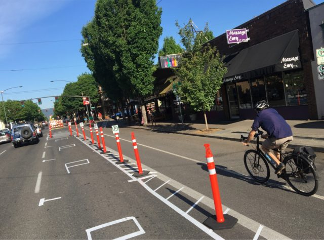 Volunteers have condensed the project and now the entire thing has a functioning parking-protected bikeway.