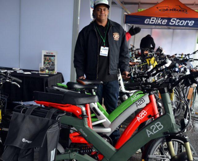 Keola Munos with A2B's heavy-duty lineup.(Photos: M.Andersen/BikePortland)