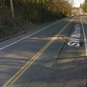 Man dies after being struck while bicycling on SW Multnomah