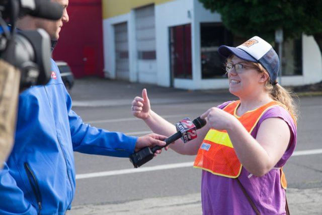 Better Block volunteer Gwen Shaw talks to a local TV crew.