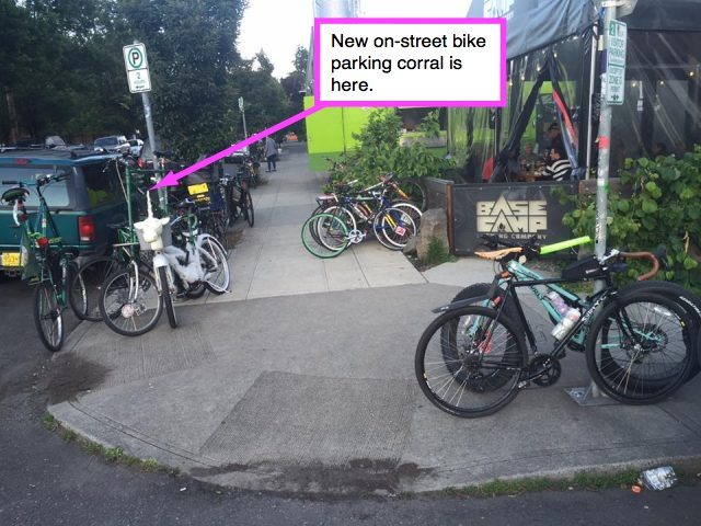 The new bike parking opens up space on the sidewalk and the street — providing safety for everyone and security for bike owners.(Photo by Ross Putnam)