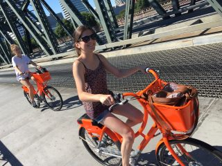 Biketown users on the Hawthorne Bridge yesterday.(Photos: J. Maus/BikePortland)