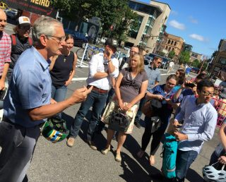 Hales spoke in the new public plaza on SW 3rd yesterday.(Photo: J. Maus/BikePortland)