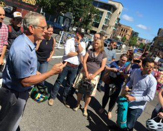 Hales spoke in the new public plaza on SW 3rd yesterday.(Photo: J. Maus/BikePortland)