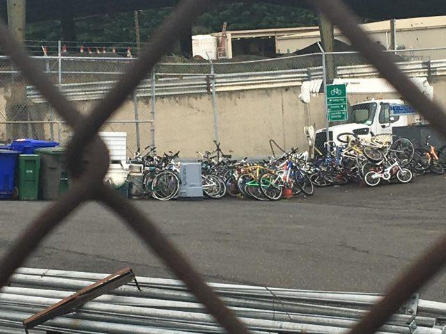 A pile of bikes at the City of Portland's Albina maintenance yard in North Portland. (Photo: J. Maus/BikePortland)