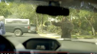 A sasquatch signals an intent to cross in the latest ODOT safety video.