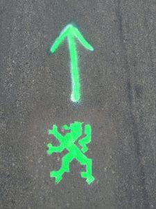 Follow the green lions.