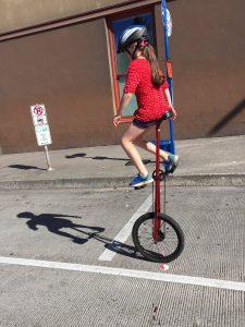 bridge-pedal-girl-on-unicycle