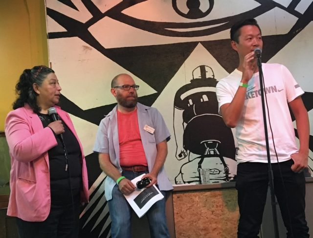 BTA Board President Justin Yuen (at the mic) with Executive Director Rob Sadowsky and a Spanish language interpreter (sorry I don't have her name yet).