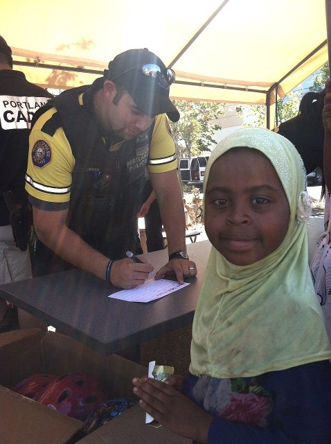 police-Ofc_Green_signing_participation_card_girl.msg