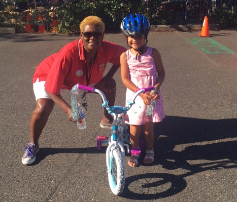 police-Officer_Jackson_with_a_girl_on_a_bike