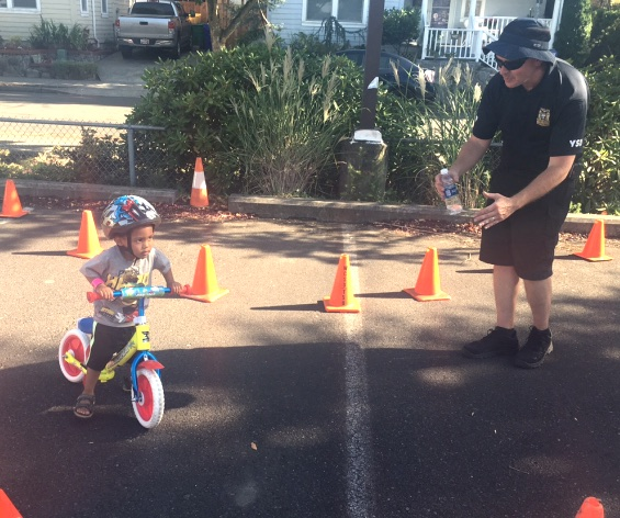 police-Officer_Morinville_encourages_young_boy_bike_rodeo