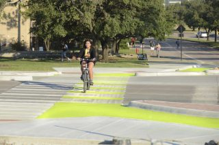 "Solar ""Dutch style"" bikeways at an intersection on Texas A & M campus.(Photo: Texas A & M Transportation Institute)"