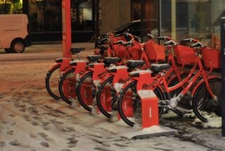 Biketown station on North Albina all tucked in and ready to go for tomorrow morning's commute.(Photo: J. Maus/BikePortland)