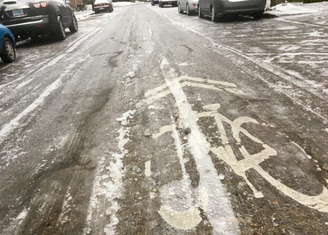 A cold sharrow on the North Michigan neighborhood greenway.