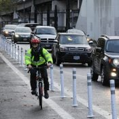 Plastic wands installed to protect bicycle users on NE Multnomah, NE 1st, and N Greeley