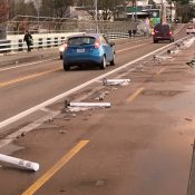 Snowplow operator uproots 30 plastic bollards on the 28th Avenue overpass