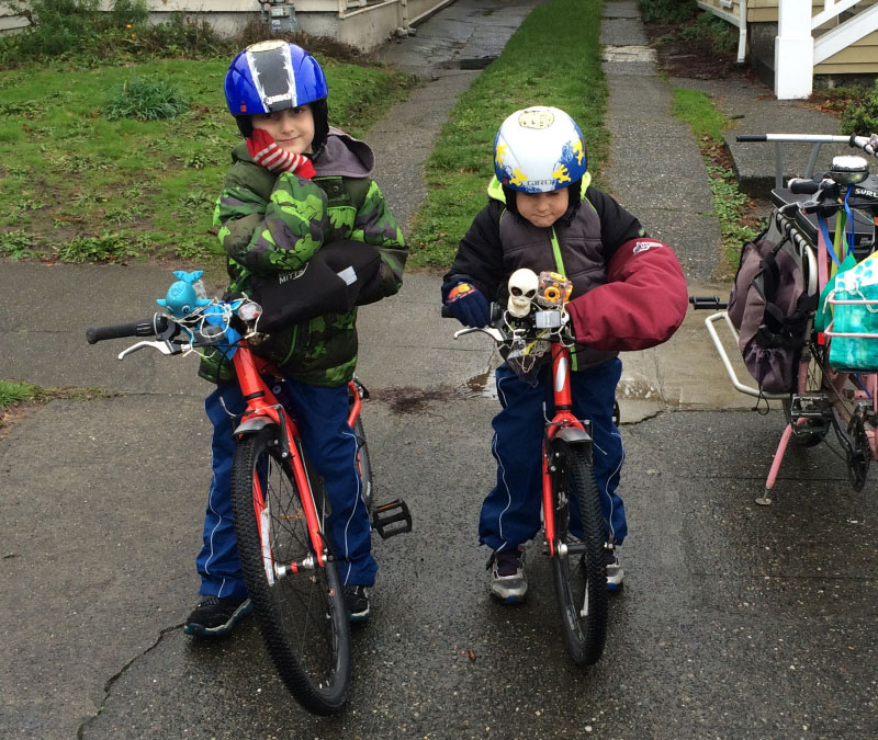 Handlebar mittens come as sets of two and work fine with shifters and brakes, though my kids like keeping their shifters visible.