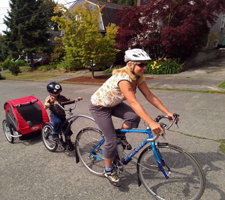 Engine-Engine-Engine is a neat way to carry three kids with a regular bike
