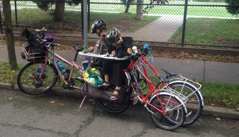 Kids and bike bikes on my bikes headed to a Kidical Mass ride, 2015