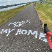 'Mask or Stay Home' graffiti on Marine Drive bike path
