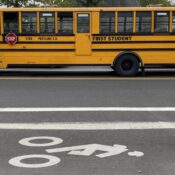 School bus blues continue amid pay raises and global finance